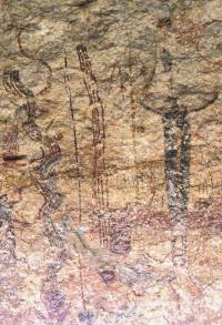 "Pecos River style pictographs in Rattlesnake Canyon. One of the serpentine ""rattlesnakes"" can be seen to the left of the dark shaman figure. Photo by Steve Black."