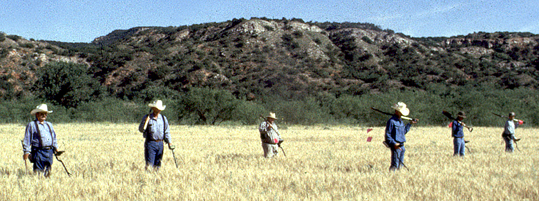 Archeologists conducting a metal detector survey at the Battle of Red River site. Photo courtesy of the Texas Historical Commission.