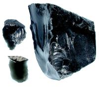 Obsidian core and flakes from a volcanic source in central Mexico.