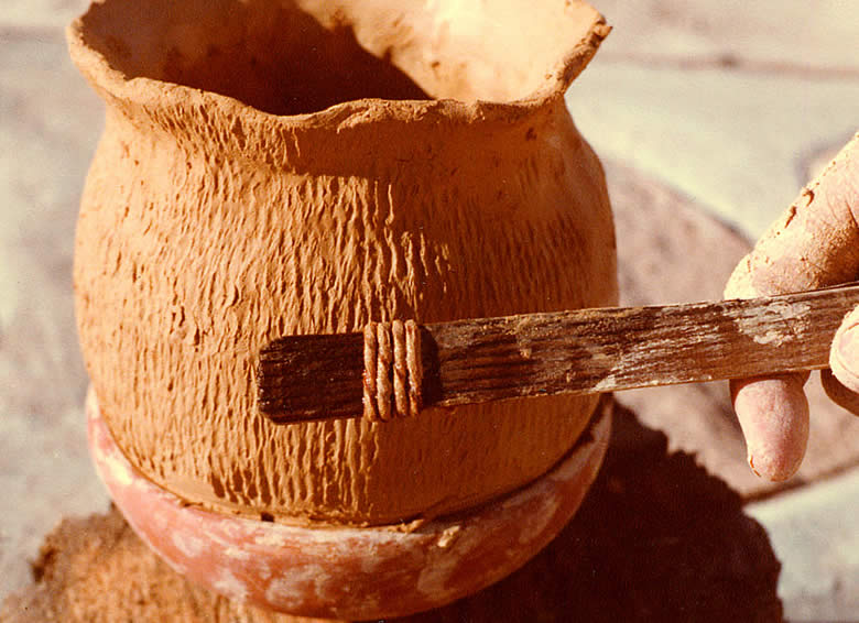 photo of closeup view of a cordmarked pot in the process of construction
